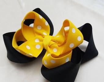 White and yellow polka dot hair bow