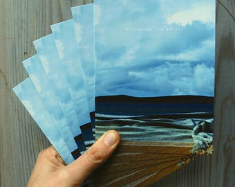 Set of 6 Seascape postcards: handwoven blanket and privatisation protest