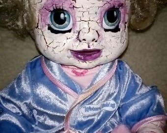 Creepy electronic doll