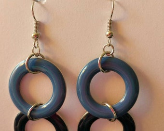 Light blue and dark blue circles with silver fishhook