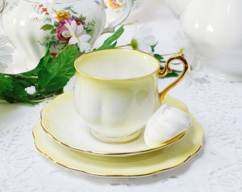 "Royal Albert  teaset : Royal Albert teaset, called  ""Rainbow"" this one is in in Lemon, 1cup, 1 saucer and 1 tea plate. Collect them all."