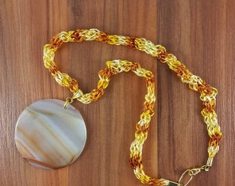 Necklace: Far Side of Jupiter. Circular Pendant in Natural Agate, with a knitted cord in artificial silk. For men or women.