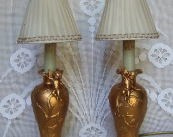 Pair of gilt pewter table lamps with puttis, cherubs circa 1880