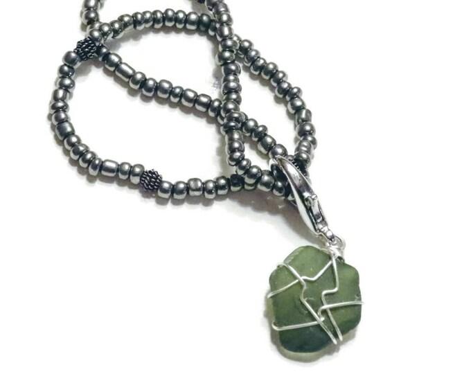 Beaded Bracelet - Rare Olive beach glass charm - gun metal gray beads - stretch bracelet - shiny - Pretty and Beachy