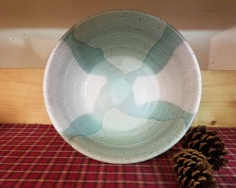 Icy turquoise and white pottery bowl