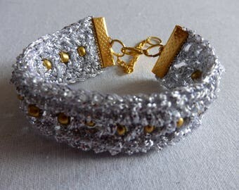 Crocheted Bracelet, Silver with golden beads.