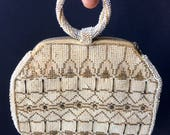 Antique beaded cream/tan/white purse, gorgeous detail, stunning bead work, great handle!  Perfect for a summer night on the town!