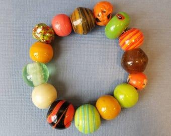 Orange and green glass bead bracelet