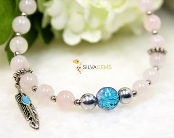Rose Quartz Gemstone Handmade Beaded Bracelet with a Blue Glass Bead and Feather Charm for Her. Love Stone Bracelet. Quartz Jewellery.