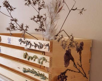 Pressed flowers on crate. Pressed Flower Art. Crate.