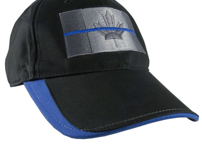A Canadian Thin Blue Line Back The Blue Silver and Royal Blue Embroidery on an Adjustable Black Structured Adjustable Fashion Baseball Cap