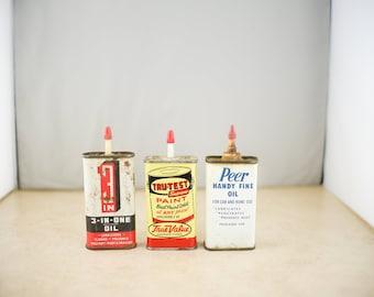 Vintage Peer, Tru-Test, and 3-in-one Oil Tins