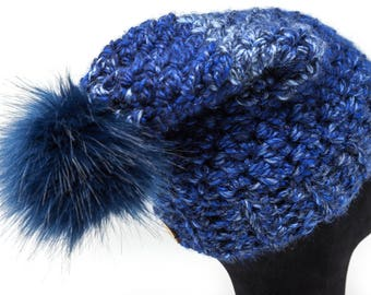 Blue iridescent slouchy hat with faux fur pom
