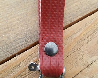 Tough keychain made of used firehose
