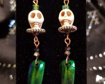 Why so Serious? Skull and green beetle wing dangling earrings