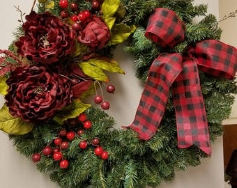 "24"" artificial evergreen wreath beautifully decorated with dark red/cranberry artificial flowers and greenery"