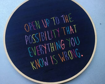 Everything you know is wrong  - hand drawn and embroidered Terence McKenna quotation hoop art wall hanging