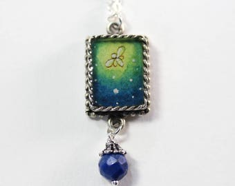 The Firefly, a Hand-painted Watercolor Necklace in Silver with Lapis Bead