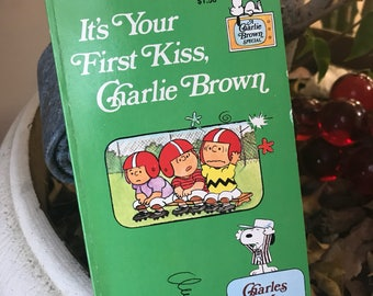 Vintage 1970s Snoopy Charlie Brown Peanuts Its your first KISS Charlie Brown paperback book