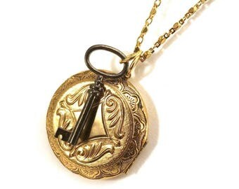 Long locket necklace with key accent