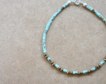 turquoise beaded bracelet with pyrite. turquoise and pyrite bracelet. thin turquoise bracelet. turquoise with pyrite detail jewelry