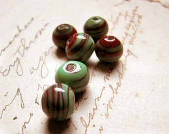 vintage toffee apple glass beads in sage green with deep red spiral stripes - handmade 1950s collectable beads