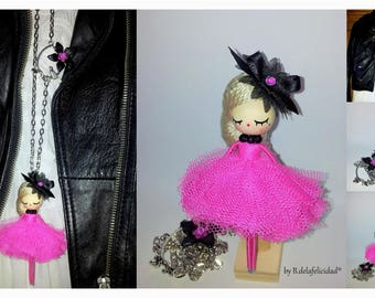 Doll necklace made and painted manually.