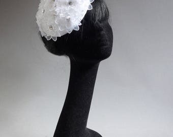 specially made for haute couture fachion show for designer Ronald Kolk this percher bridal hat with flowers and stras on comb