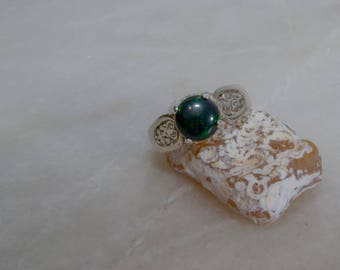 Decorative black opal ring.