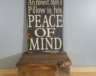"Mellencamp quote. Wooden, Rustic, Hand Painted Sign.  ""An honest man's pillow is his peace of mind"""