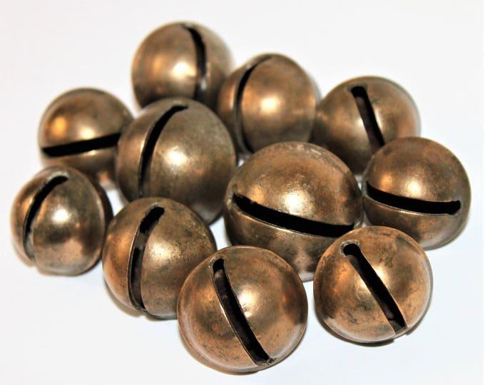 Eleven Antique Brass Sleigh Bells