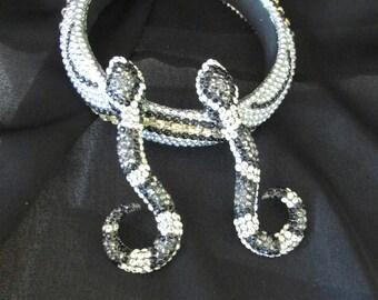 black and white bead and rhinestone studded bangle and snake earrings