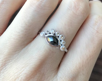 Unique Marquise Black Diamond Ring featuring a Halo of Champagne Diamond in 18k White Gold
