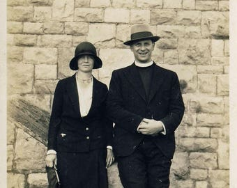 Vintage photograph of churchman and woman on the beach c1920s