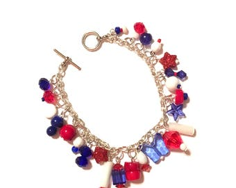 Bracelet. Charm Bracelet. Red, Blue and White. 7.5 Inches Long.