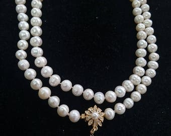 Double strand knotted pearl necklace with gold filled center