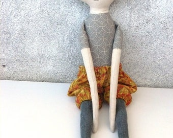 48 cm linen doll. Hand embroidered face.