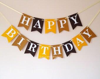 Happy birthday bunting banner decoration in walnut, yellow gold, dark brown