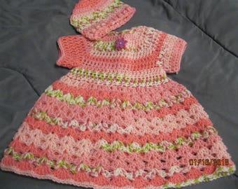 Newborn baby dress with beanie style hat.