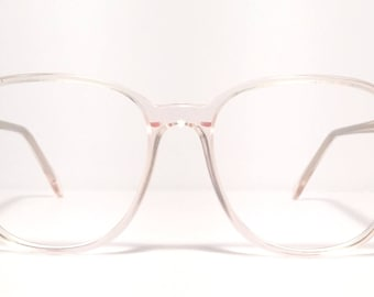 Vintage eyewear. Ralph Lauren 1980's. Rounded shape. Pale pink color Polo. Made in Canada. Excellent quality and condition! Hip Preppy!