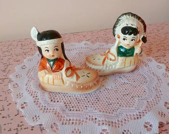 Vintage native salt and pepper shakers