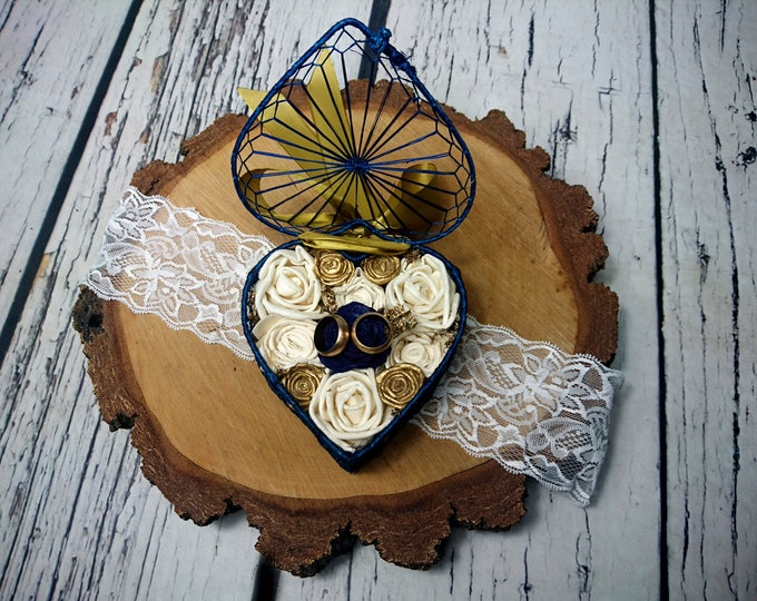 Navy blue gold wedding rings box with sola flowers