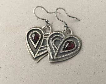 Silver heart earrings with red garnets, rustic textured handmade earrings