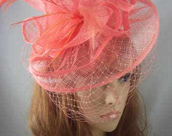 Coral Pink Sinamay Fascinator With Birdcage Veil - Occasion Wedding Races