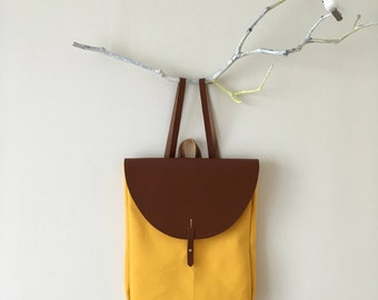 Small canvas backpack with leather details
