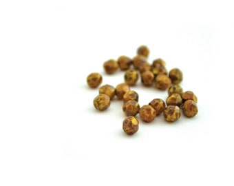 25 yellow and Brown Czech faceted 6mm beads