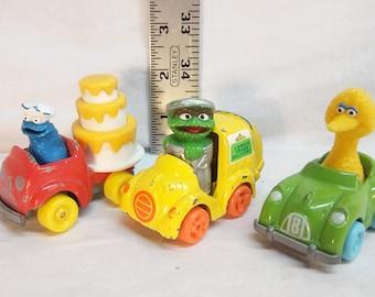 Vintage 1982 Playskool Sesame Street Diecast Cars: Cookie Monster, Big Bird, and Oscar