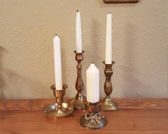 Vintage brass candlestick collection.  Set of 4 vintage candleholders.  Boho, eclectic candlesticks