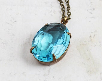 Aqua Blue Oval Rhinestone Necklace with Silver Plated or Antiqued Brass Chain (Vintage Glass Stone)
