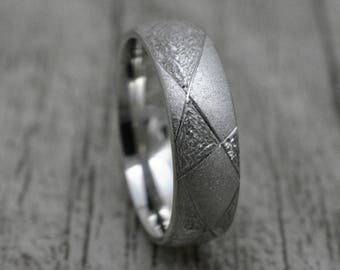Interesting silver ring with pattern